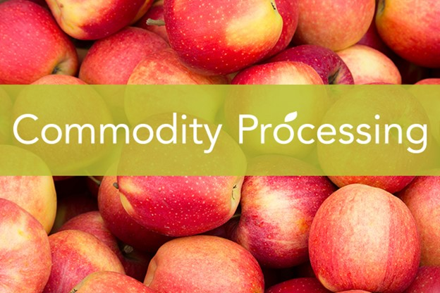 Group of apples with text banner across image that states commodity processing