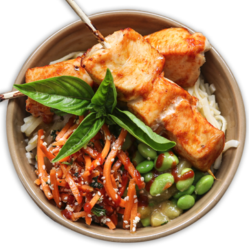 Noodle bowl with chicken skewers